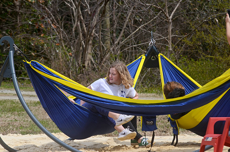 students sitting in hammocks