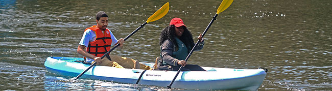 two people paddling a kayack